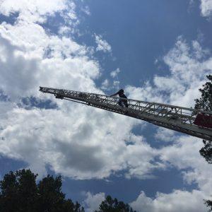 Michael Sullivan on a 100-foot ladder